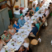 Guests at the community table in the barn